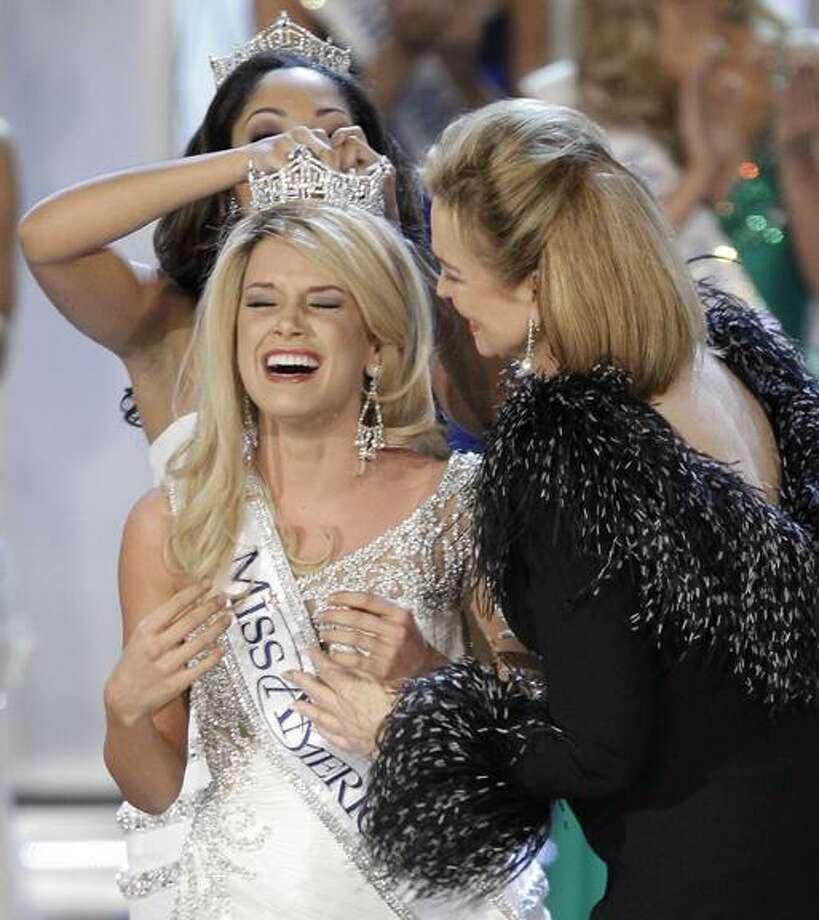 Teresa Scanlan, Miss Nebraska is crowned Miss America 2011 during the Miss America pageant, Saturday, Jan. 15, 2011 in Las Vegas. (AP Photo/Julie Jacobson) Photo: ASSOCIATED PRESS / AP2011