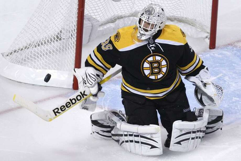 Boston Bruins goalie Tim Thomas makes a save against the Philadelphia Flyers during the third period in Game 3 of the Eastern Conference semifinal NHL Stanley Cup hockey playoff series in Boston, Wednesday, May 4, 2011. (AP Photo/Charles Krupa) Photo: ASSOCIATED PRESS / AP2011