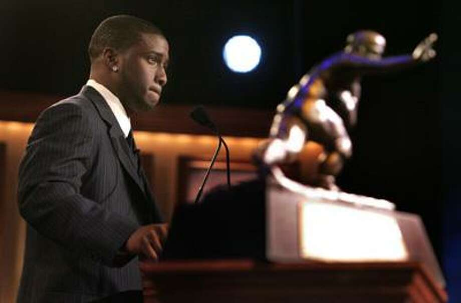 In this Dec. 10, 2005, file photo, Southern California tailback back Reggie Bush pauses while giving his acceptance speech as the winner of the Heisman Trophy award in New York. (AP) Photo: ASSOCIATED PRESS / AP