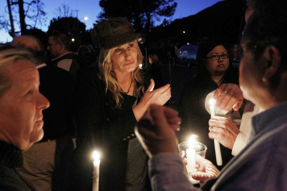Actress Daryl Hannah, center, and other protestors participate in a candlelight vigil in support of tree-sitters who are attempting to keep oak trees from being felled in Arcadia, Calif. on Wednesday. Los Angeles County public works officials say the trees covering 11 acres in foothills above the city of Arcadia must be cleared away for a public works project.  (AP Photo/Matt Sayles) Photo: ASSOCIATED PRESS / AP2011