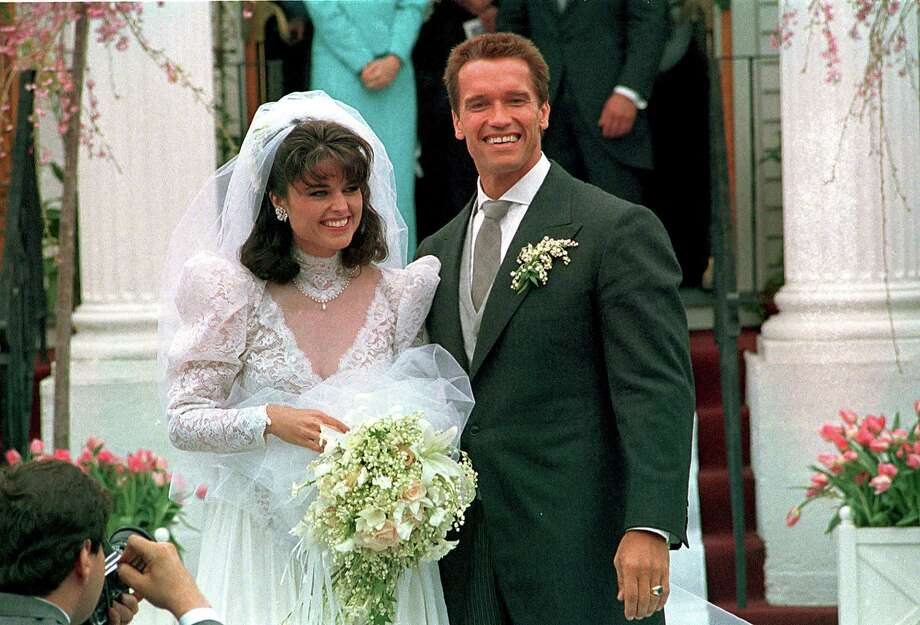 In an April 25, 1986 file photo, Actor Arnold Schwarzenegger poses with his bride Maria Shriver following their wedding ceremony in Hyannis, Mass. Former California Gov. Arnold Schwarzenegger and his wife of 25 years, Maria Shriver, announced Monday that they are separating. (AP Photo/file) Photo: AP / 1986 AP