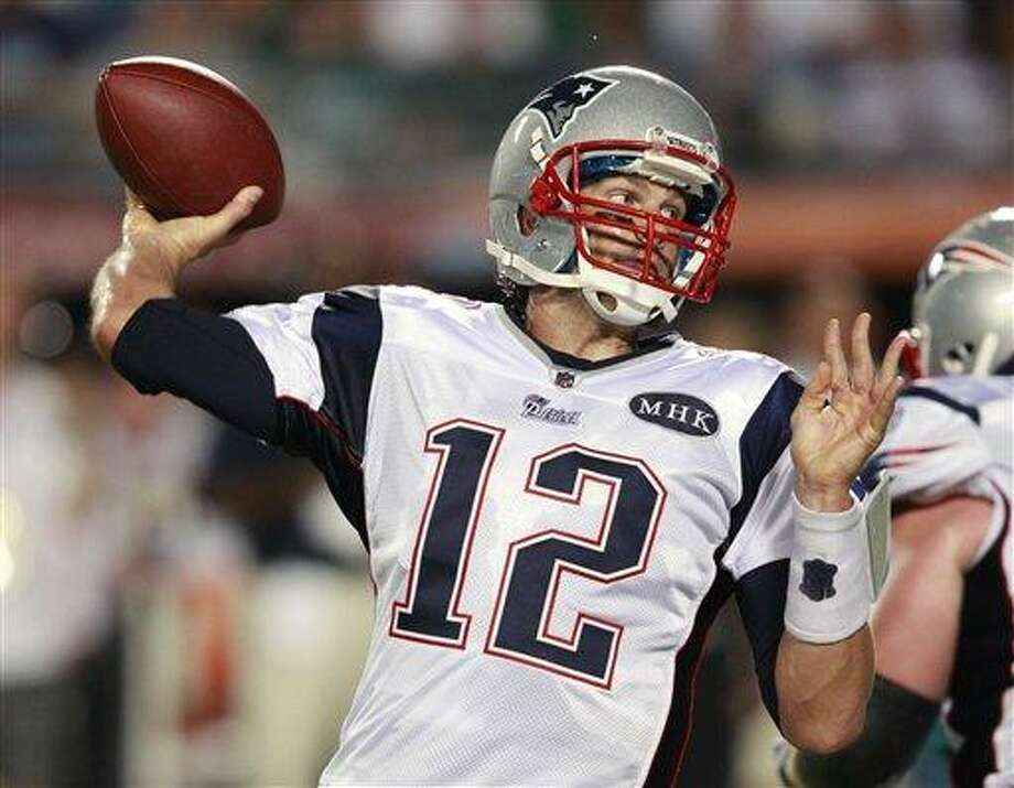 New England Patriots quarterback Tom Brady throws during the first half of an NFL football game against the Miami Dolphins, Monday, Sept. 12, 2011, in Miami. Brady threw for a team-record 517 yards and four TDs as the Patriots won 38-24. (AP Photo/Wilfredo Lee) Photo: AP / AP