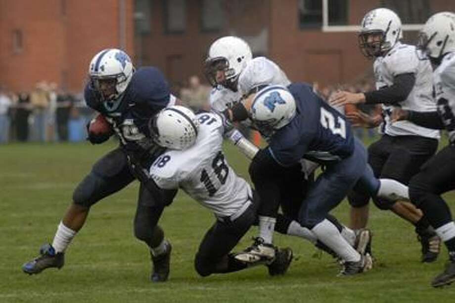 Middletown running back, Shacor Privott, runs with the ball during last year's Thanksgiving Day City Bowl against Xavier at Wesleyan University. (Max Steinmetz