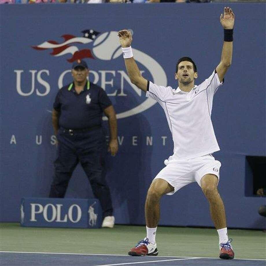 Novak Djokovic of Serbia reacts after winning the men's championship match against Rafael Nadal of Spain at the U.S. Open tennis tournament in New York, Monday, Sept. 12, 2011. (AP Photo/Matt Slocum) Photo: AP / AP