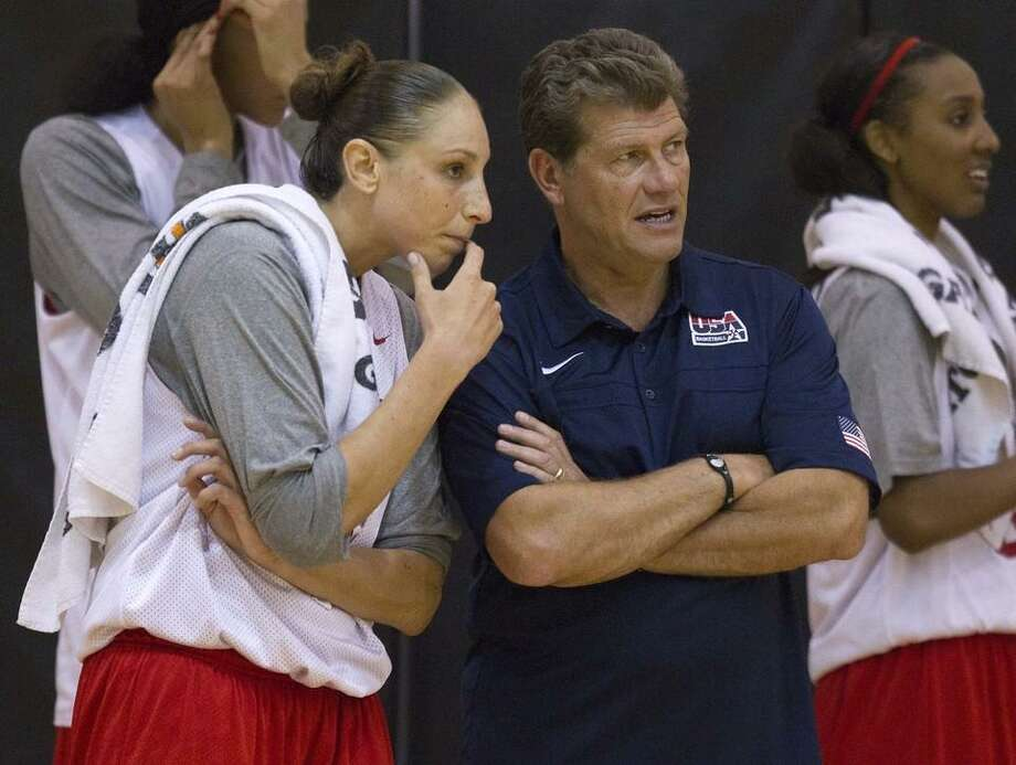 United States women's national basketball team coach Geno Auriemma, second from right, talks with Diana Taurasi, left, during the team's practice, Tuesday, May 10, 2011, in Las Vegas.  (AP Photo/Julie Jacobson) Photo: ASSOCIATED PRESS / AP2011