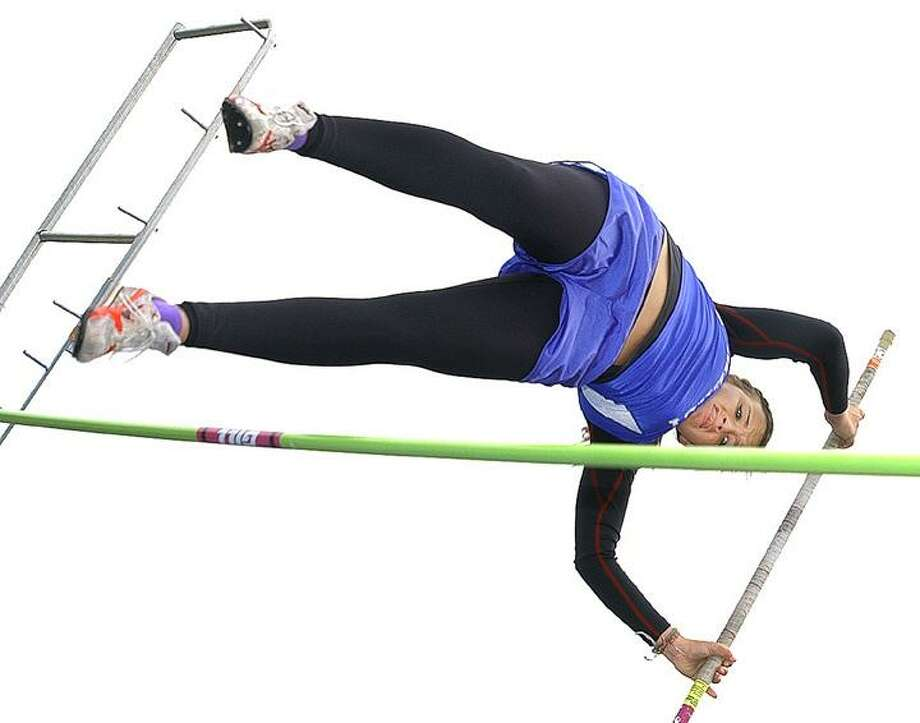 """Mercy's Jess Nielsen clears 8'6"""" to win the pole vaulting event against Hamden. (Catherine Avalone / The Middletown Press)"""
