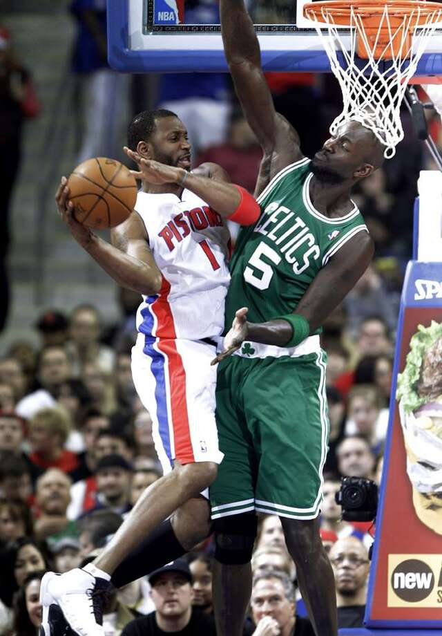 Detroit Pistons guard Tracy McGrady (1) drives on Boston Celtics forward Kevin Garnett in the first quarter of their NBA basketball game in Auburn Hills, Mich., Wednesday, Dec. 29, 2010. (AP Photo/Paul Sancya)