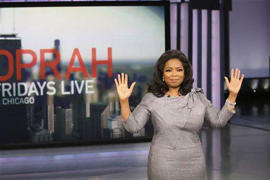 """In this Nov. 20, 2009 file photo originally provided by Harpo Productions Inc., talk-show host Oprah Winfrey announces during a live broadcast of """"The Oprah Winfrey Show"""" in Chicago that her daytime television show, the foundation of a multibillion-dollar media empire with legions of fans, will end its run in 2011 after 25 seasons on the air. On Monday, Sept. 13, 2010, the 25th and final season of """"The Oprah Winfrey Show"""" starts airing. (AP Photo/Harpo Productions, Inc., George Burns, File) Photo: AP / AP2009"""