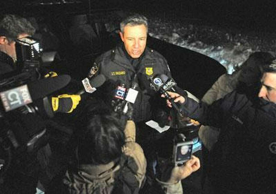 Cheshire Police Lt. Jim Fasano speaks to the media after the pilot of a single-engine plane origininating in New Bedford, MA was forced to make an emergency landing in Boulder Road in Cheshire.  The plane was bound for Oxford, CT.  (Photo by Brad Horrigan/New Haven Register)