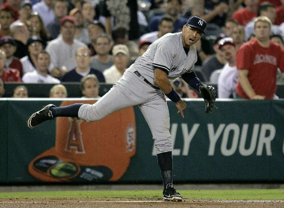 ASSOCIATED PRESS New York Yankees third baseman Alex Rodriguez throws out Los Angeles Angels' Vernon Wells at first base in the sixth inning of Friday's game in Anaheim, Calif.