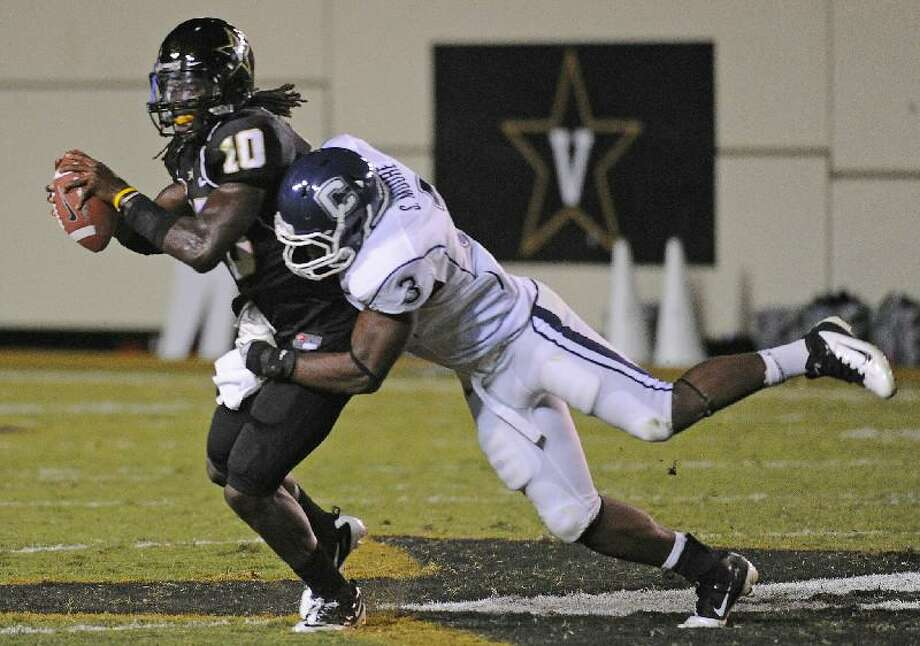 ASSOCIATED PRESS Connecticut linebacker Sio Moore (3) sacks Vanderbilt quarterback Larry Smith in the second quarter of Saturday's game in Nashville, Tenn.