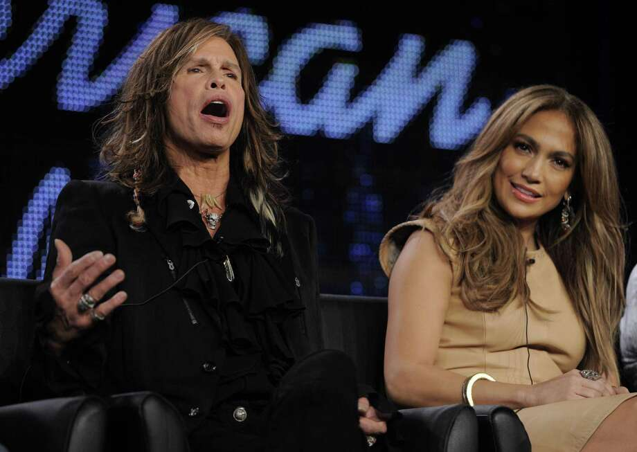 """Steven Tyler, left, and Jennifer Lopez, new judges on """"American Idol,"""" take part in a panel discussion on the show during the FOX Broadcasting Company Television Critics Association winter press tour in Pasadena, Calif., Tuesday. (AP Photo/Chris Pizzello) Photo: AP / AP"""