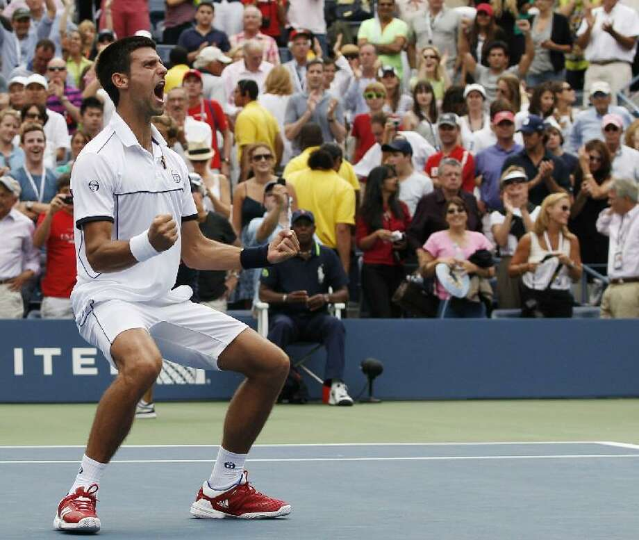 ASSOCIATED PRESS Novak Djokovic of Serbia reacts after winning a semifinal match against Roger Federer of Switzerland at the U.S. Open tennis tournament in New York, Saturday.