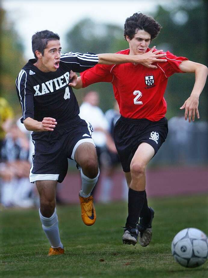 Xavier's Fabrocio Liseo goes against Wilbur Cross' Lucas Bramo for a loose ball in a game on Sept. 22, 2009. The Falcons open the 2010 season against Notre Dame-West Haven. (Catherine Avalone