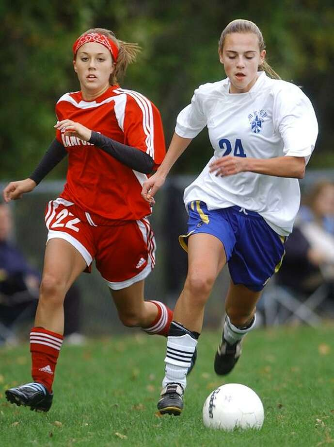 Mercy's Victoria Hendel is challenged by Branford's Jessica Lengyel during the first half of an Oct. 13, 2009 match. Catherine Avalone