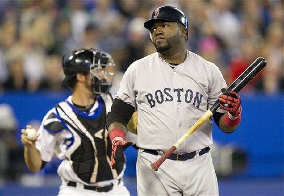 Boston Red Sox's David Ortiz, right, reacts in front of Toronto Blue Jays' J.P. Arencibia after striking out in the eighth inning of MLB baseball game action in Toronto Thursday, Sept. 8, 2011. The Blue Jays defeated the Red Sox 7-4. (AP Photo/The Canadian Press, Darren Calabrese) Photo: AP / The Canadian Press