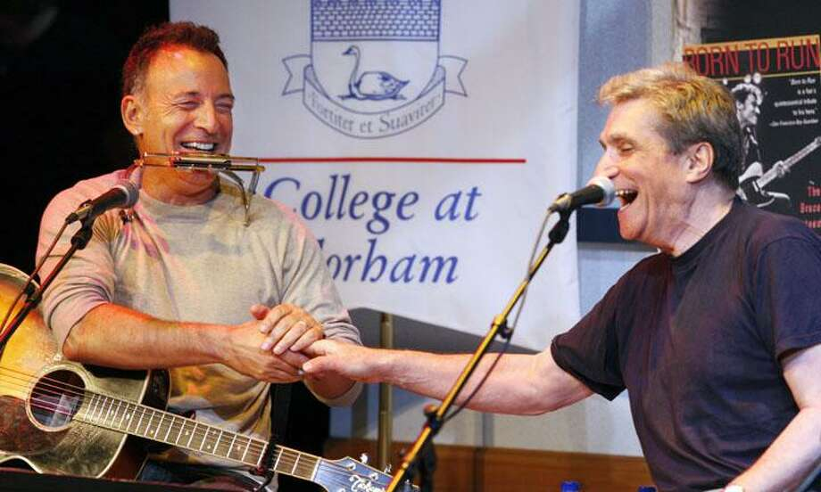 Bruce Springsteen and former U.S. poet Laureate Robert Pinsky laugh as they shake hands while performing together on stage at Fairleigh Dickinson University Thursday in Madison, N.J. Less than a week after his induction into New Jersey's Hall of Fame, rocker Springsteen performed and talked about song writing to students at Fairleigh Dickinson University. (AP) Photo: AP / POOL AP