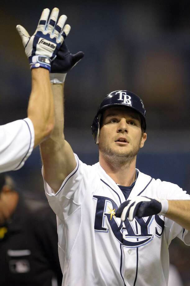 Tampa Bay Rays' John Jaso is congratulated at home plate by teammate Johnny Damon after hitting a two-run home run off Boston Red Sox starter John Lackey during the second inning of a baseball game in St. Petersburg, Fla., Friday, Sept. 9, 2011. (AP Photo/Phelan M. Ebenhack) Photo: ASSOCIATED PRESS / AP2011