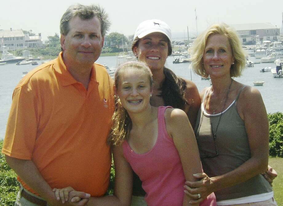 This June 2007 photo provided by Dr. William Petit Jr., shows Dr. Petit, left, with his daughters Michaela, front, Hayley, center rear, and his wife, Jennifer Hawke-Petit, on Cape Cod, Mass. Dr. Petit was severely beaten and his wife and two daughters were killed during a home invasion in Cheshire, Conn., July 23, 2007. A trial for Steven Hayes, one of two men charged with the crimes, begins Monday, Sept. 13, 2010 in New Haven, Conn., Superior Court. (AP Photo/William Petit)  NO SALES Photo: AP / William Petit, Jr.