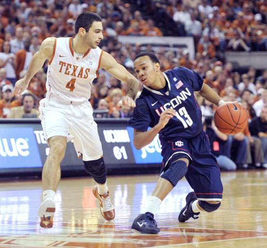 AP Connecticut guard Shabazz Napier (13) pulls back from a drive against Texas guard Dogus Balbay (4) during the second half of a Jan. 8 in Austin, Texas. Connecticut won 82-81 in overtime. Napier has provided plenty of energy off the bench for the Huskies this season.