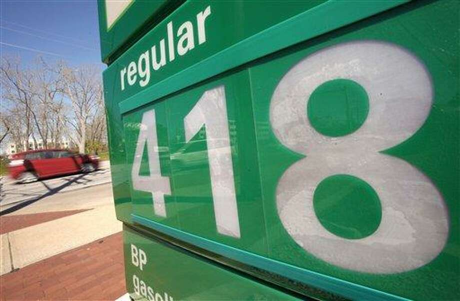 In this May 5, 2011 photo, the price for one gallon of unleaded regular gasoline is seen on the sign outside a BP gas station in Beachwood, Ohio. Americans are switching to more fuel efficient cars and driving fewer miles, but purchases of gasoline are still gobbling up an increasing chunk of the nation's pocketbook. (AP Photo/Amy Sancetta) Photo: AP / AP