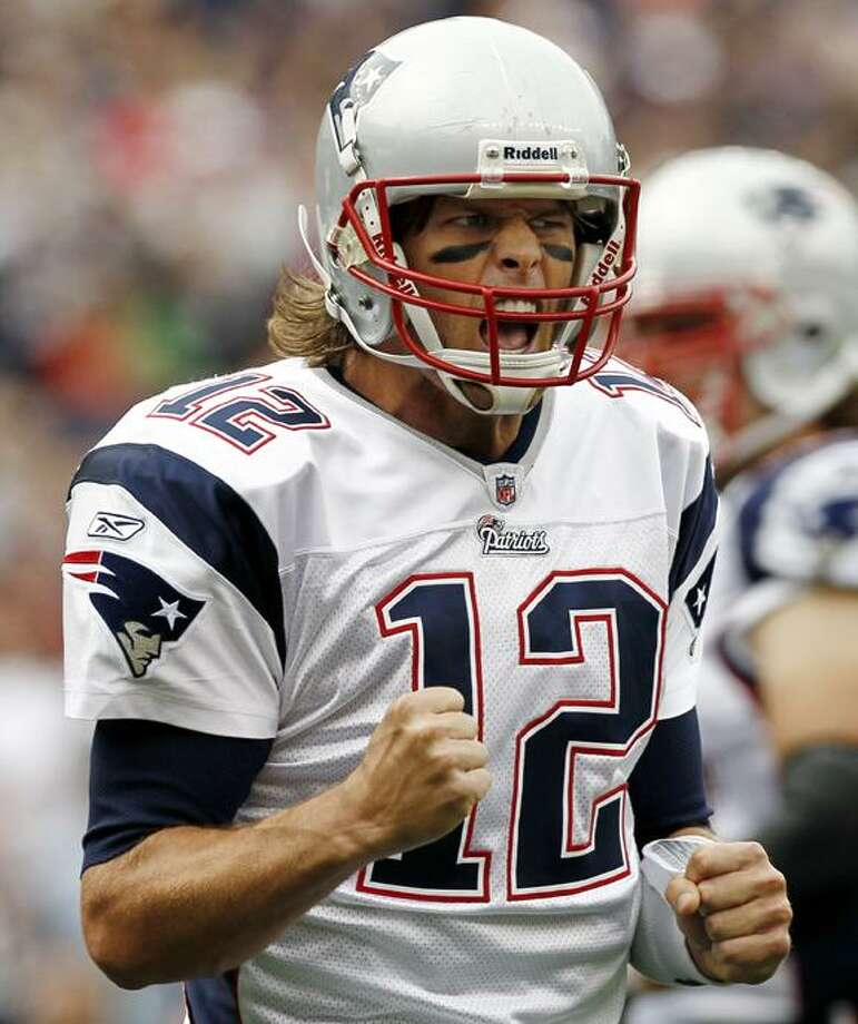 New England Patriots quarterback Tom Brady celebrates a touchdown during the first quarter of an NFL football game against the Cincinnati Bengals at Gillette Stadium in Foxborough, Mass., Sunday. (AP Photo/Winslow Townson) Photo: AP / FR170221 AP
