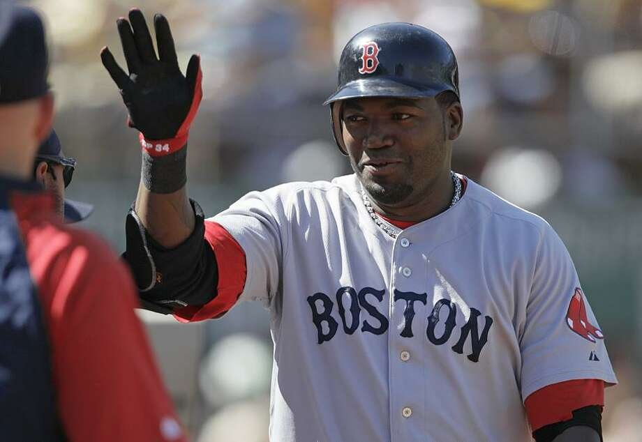 Boston Red Sox's David Ortiz celebrates after scoring against the Oakland Athletics during the sixth inning of a baseball game Sunday in Oakland, Calif. Ortiz scored on a two-run double by teammate J.D. Drew. (AP Photo/Ben Margot) Photo: AP / AP