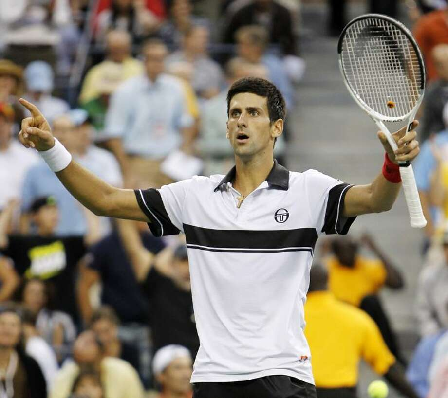 Novak Djokovic, of Serbia, reacts after defeating Roger Federer, of Switzerland, in five sets in a men's semifinal match at the U.S. Open tennis tournament in New York, Saturday.  (AP Photo/Mark Humphrey) Photo: AP / AP