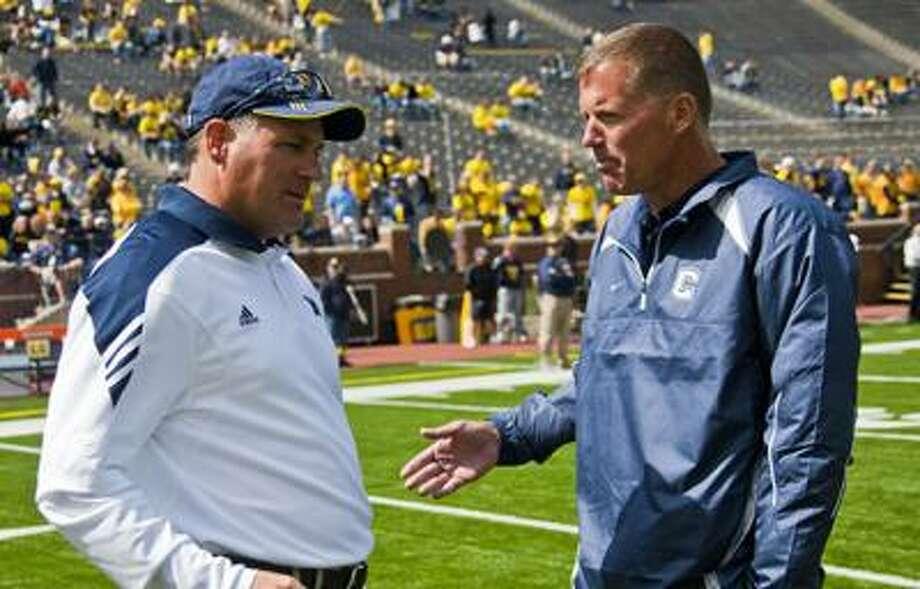 Michigan head coach Rich Rodriguez, left, speaks with Connecticut head coach Randy Edsall, before an NCAA college football game, Saturday, Sept. 4 in Ann Arbor, Mich. (AP) Photo: ASSOCIATED PRESS / FR143848 AP