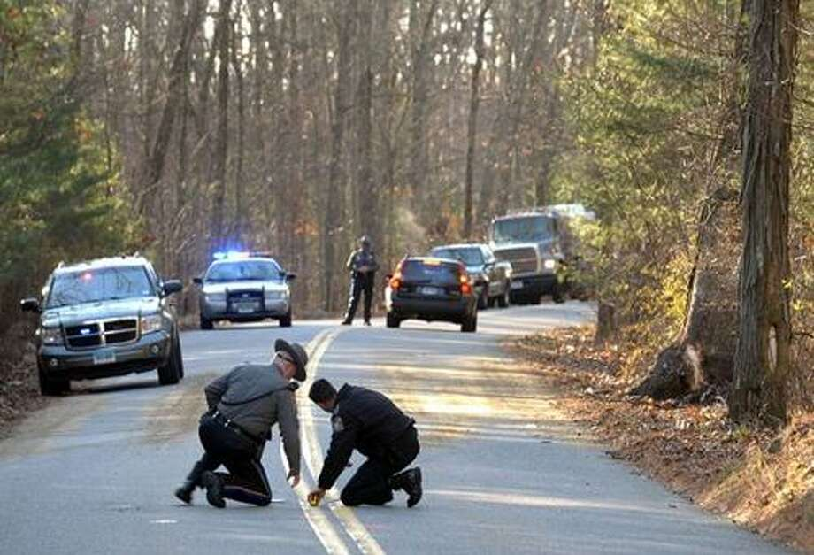Photo/New London Day. State Police continued their investigation Dec. 8, 2010 at the scene of the fatal accident on route 201 in Griswold.