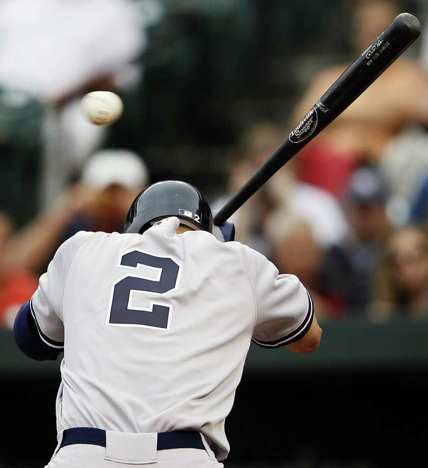 New York Yankees' Derek Jeter ducks to avoid a pitch by Baltimore Orioles pitcher Alfredo Simon in the fourth inning of a baseball game on Thursday, Sept. 8, 2011, in Baltimore. (AP Photo/Patrick Semansky) Photo: ASSOCIATED PRESS / AP2011
