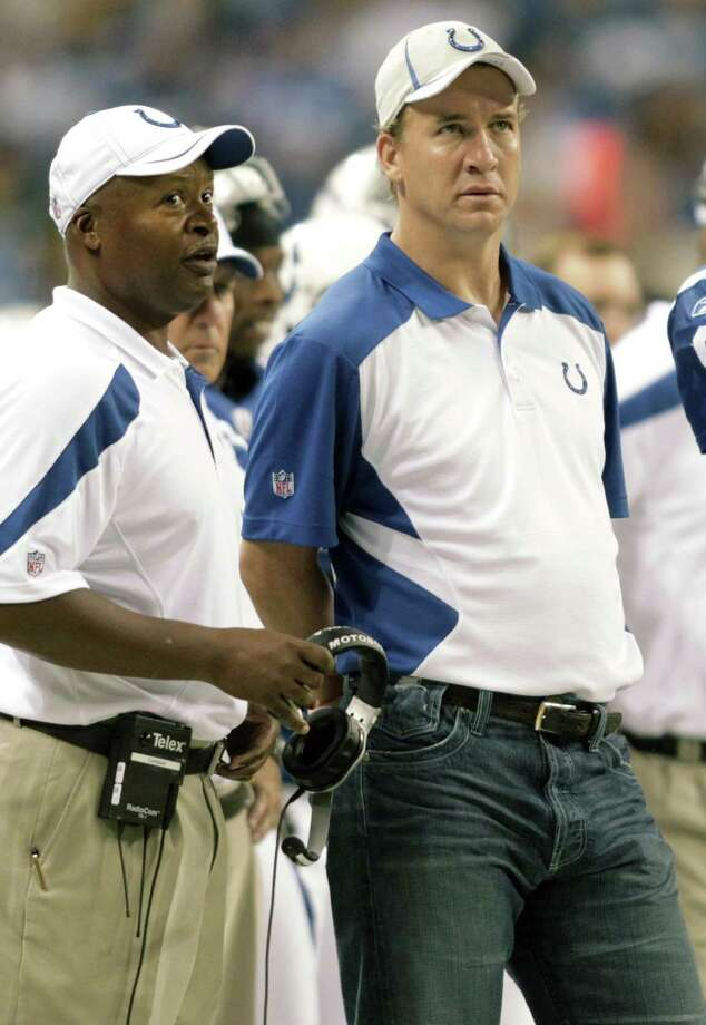 FILE - In this  Aug. 26, 2011, file photo, Indianapolis Colts quarterback Peyton Manning, right, talks with head coach Jim Caldwell during the second quarter of an NFL preseason football game against the Green Bay Packers in Indianapolis. Manning will not play Sunday, Sept. 11, 2011, in the season opener at Houston, bringing an end to his streak of 227 consecutive starts, including the playoffs. The team said 38-year-old Kerry Collins will start against the Texans as Manning continues his long recovery from neck surgery in May.(AP Photo/AJ Mast, File) Photo: ASSOCIATED PRESS / AP2011