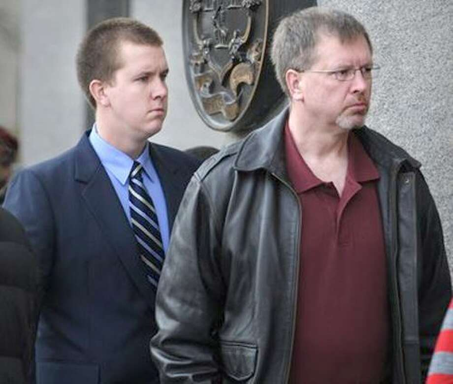 Robert Koistinen, right, pleaded not guilty Tuesday to hindering prosecution and interfering with an officer. At left is his son, Michael Koistinen.