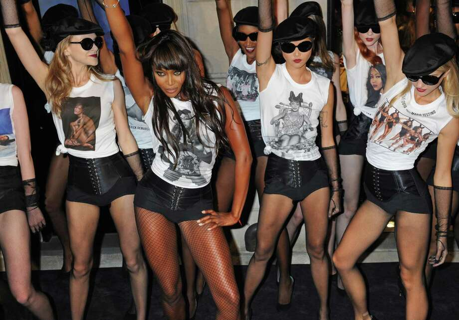 """Naomi Campbell performs with models to celebrate the 25th anniversary of her career in front of the Madison Avenue Dolce & Gabbana store, Friday, Sept. 10, in New York. 25th anniversary T-shirts will be available and will support the charity """" Fashion for Relief"""" founded by Naomi. ( AP Photo/ Louis Lanzano) Photo: AP / FR77522 AP"""