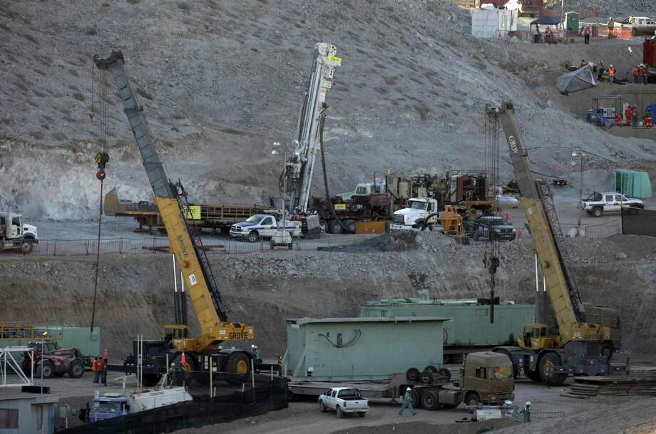 A parts of a newly arrived drill, center, to be used in the rescue operation of trapped miners is seen at the San Jose mine in Copiapo, Chile, Friday. Thirty-three miners have been trapped deep underground in the copper and gold mine since it collapsed on Aug. 5. (AP Photo/Aliosha Marquez) Photo: ASSOCIATED PRESS / AP