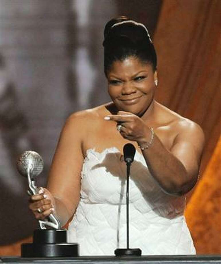 """(AP) Mo'Nique accepts the award for outstanding supporting actress in a motion picture for her role in Precious: Base on the Novel 'Push' by Sapphire"""" at the 41st NAACP Image Awards on Friday. Photo: AP / AP"""