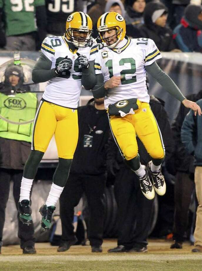 Green Bay Packers wide receiver James Jones (89) and quarterback Aaron Rodgers (12) celebrate a touchdown pass from Rodgers to Jones in the second quarter of the NFL NFC Wild Card playoff football game against the Philadelphia Eagles at Lincoln Financial Field, Sunday, Jan. 9, 2011, in Philadelphia. The Packers won 21-16. (AP Photo/The Express-Times, Matt Smith) Photo: ASSOCIATED PRESS / AP2011