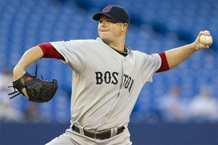 Boston Red Sox starting pitcher Jon Lester works against the Toronto Blue Jays during the first inning of a baseball game in Toronto Tuesday, Sept. 6, 2011. (AP Photo/The Canadian Press, Darren Calabrese) Photo: AP / The Canadian Press