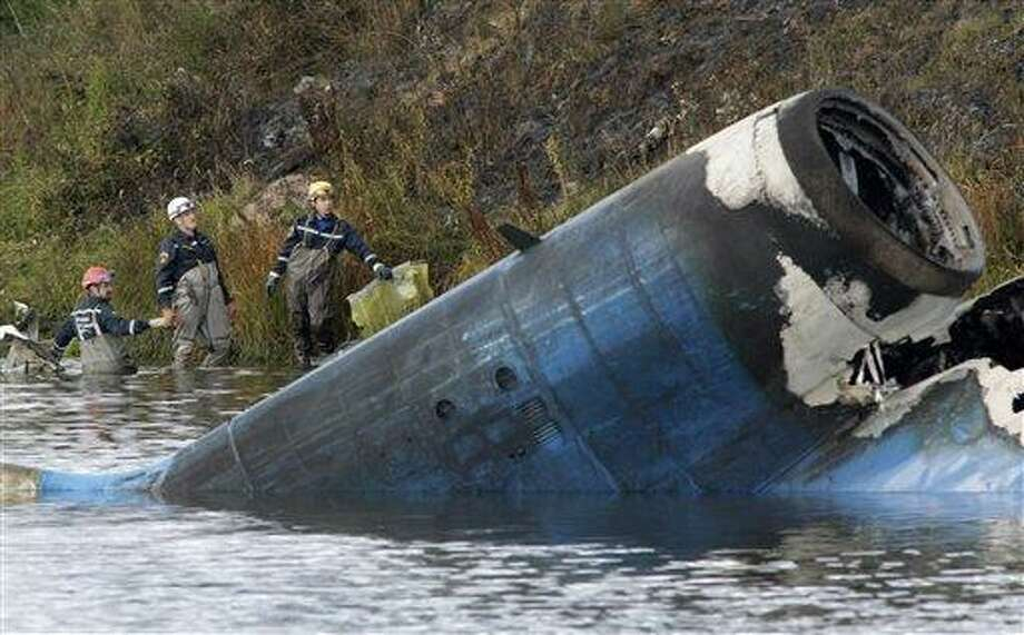 Rescuers work at the crash site of a Russian Yak-42 jet near the city of Yaroslavl, on the Volga River about 150 miles (240 kilometers) northeast of Moscow,  Russia, Wednesday, Sept. 7, 2011. The Yak-42 jet carrying a top ice hockey team crashed while taking off Wednesday in western Russia. The Russian Emergency Situations Ministry said the plane was carrying the Lokomotiv ice hockey team from Yaroslavl.(AP Photo/Misha Japaridze) Photo: AP / AP