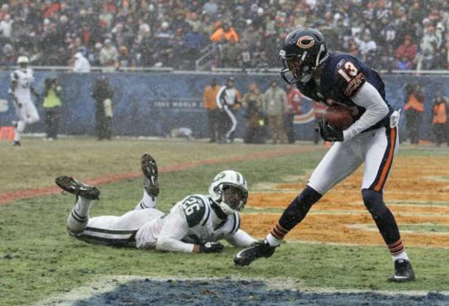 In this Dec. 26, 2010, photo, Chicago Bears wide receiver Johnny Knox (13) makes a catch in the end zone past New York Jets cornerback Dwight Lowery (26) during an NFL football game in Chicago. Knox emerged as the team's primary deep threat with 51 catches for 960 yards, including 17 for 20 yards or more (AP Photo/Darron Cummings) Photo: AP / AP2010