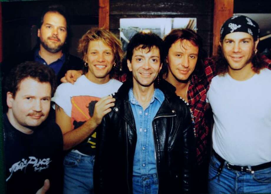 Mike Spoerndle, top left, and Brian Phelps, bottom left, are photographed with members of Bon Jovi at Toad's Place in New Haven.
