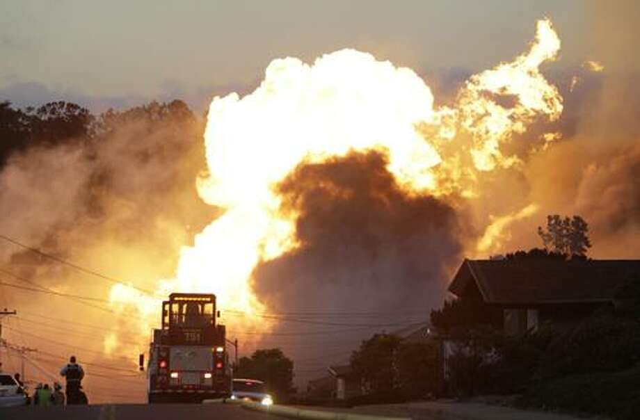 A massive fire is roars through a mostly residential neighborhood in San Bruno, Calif., Thursday, Sept. 9, 2010. Firefighters from San Bruno and surrounding cities are battling the blaze that started on a hillside and is now consuming homes in a residential neighborhood.  (AP Photo/Paul Sakuma) Photo: ASSOCIATED PRESS / AP