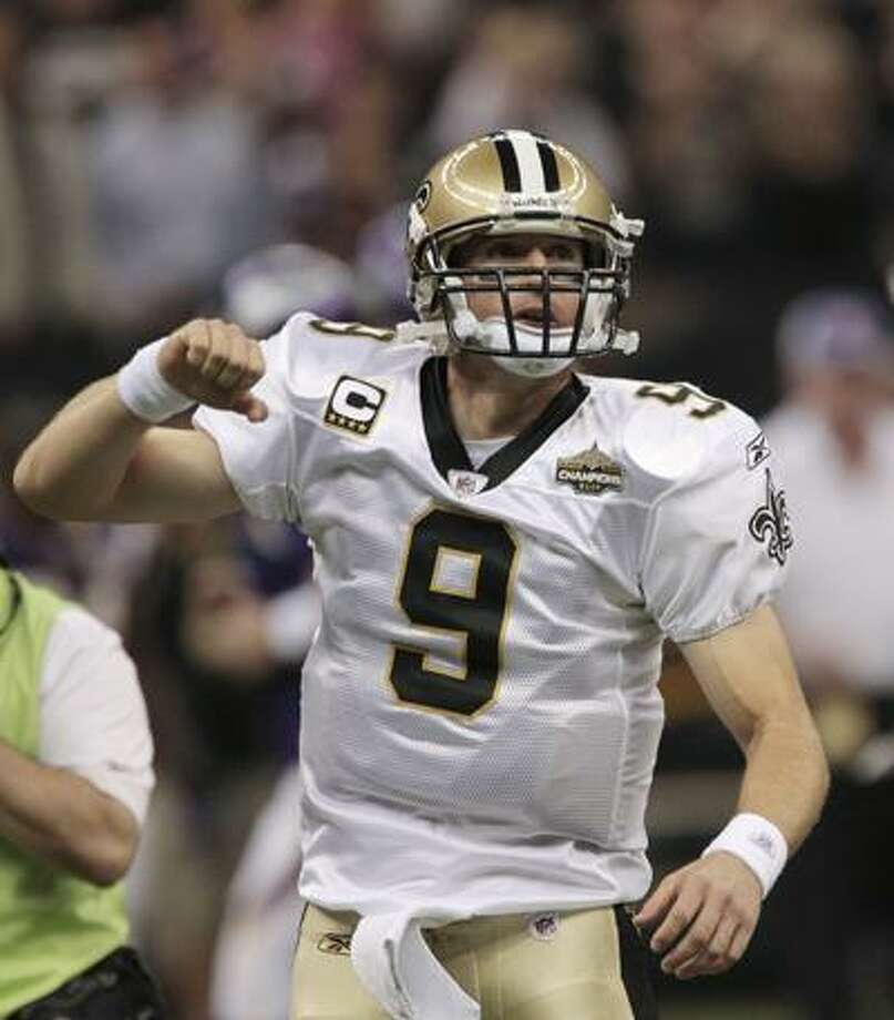 """New Orleans Saints quarterback Drew Brees leads the crowd in a """"Who Dat"""" cheer prior to an NFL football game against the Minnesota Vikings in New Orleans, Thursday. (AP) Photo: AP / AP"""