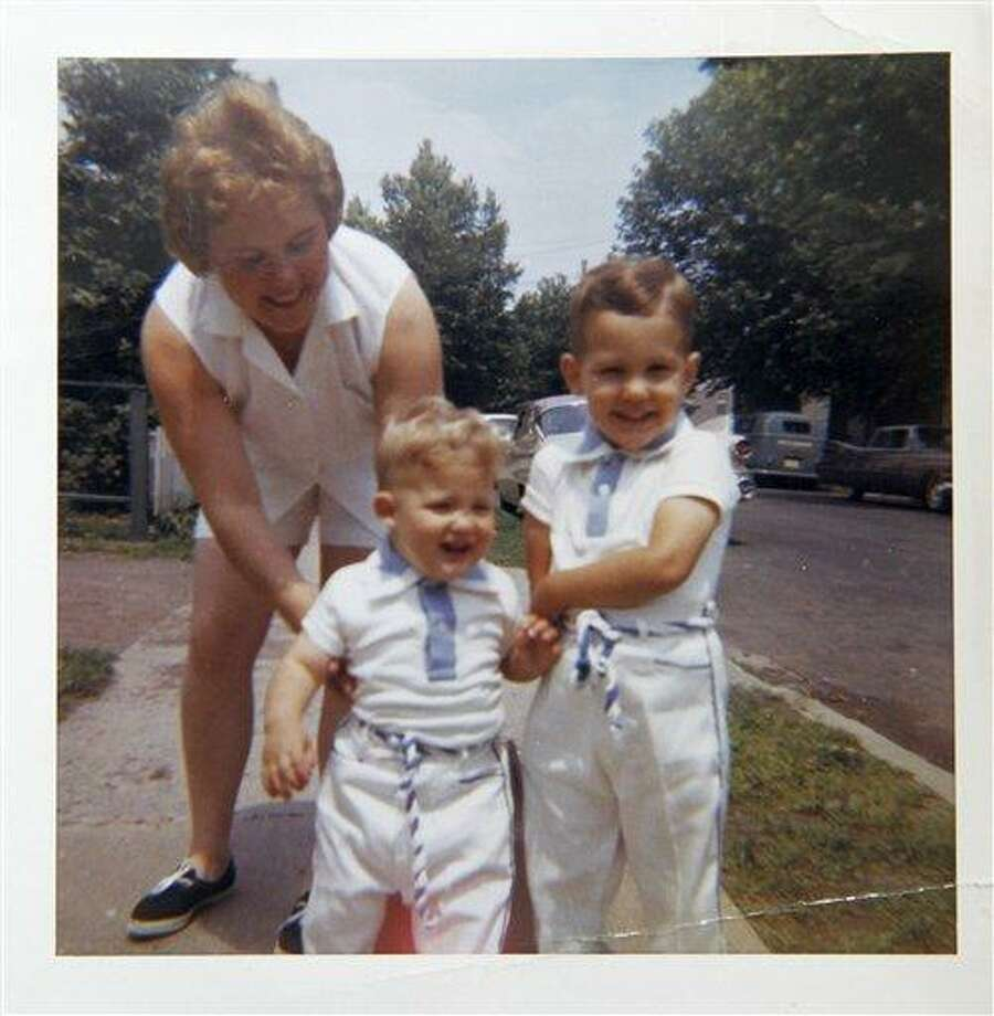 In this undated photograph provided by Sandra Grazioso, Sandra Grazioso, left, is seen with her sons Tim Grazioso, right, and John Grazioso in Clifton, N.J. Sandra Grazioso lost her two sons, who worked on separate floors of the North Tower for Cantor Fitzgerald, during the Sept. 11 attacks. (AP Photo/Courtesy of Sandra Grazioso) Photo: AP / Sandra Grazioso