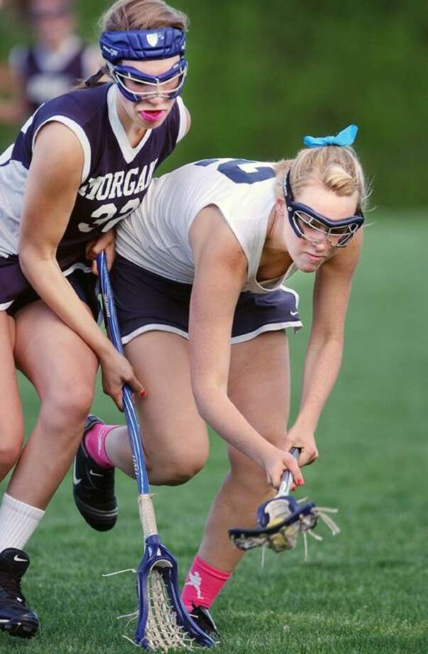 H-K captain Camille Kostek wins possession of a loose ball against Morgan's Mackenzie Taylor during a home game on Courgars' turf. H-K defeated Morgan. 14-3. (Catherine Avalone / The Middletown Press)