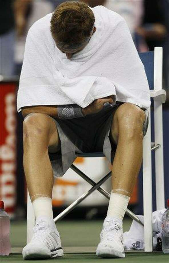 Mardy Fish reacts during the game against Jo-Wilfried Tsonga of France during the U.S. Open tennis tournament in New York, Monday, Sept. 5, 2011. (AP Photo/Mel Evans) Photo: AP / AP