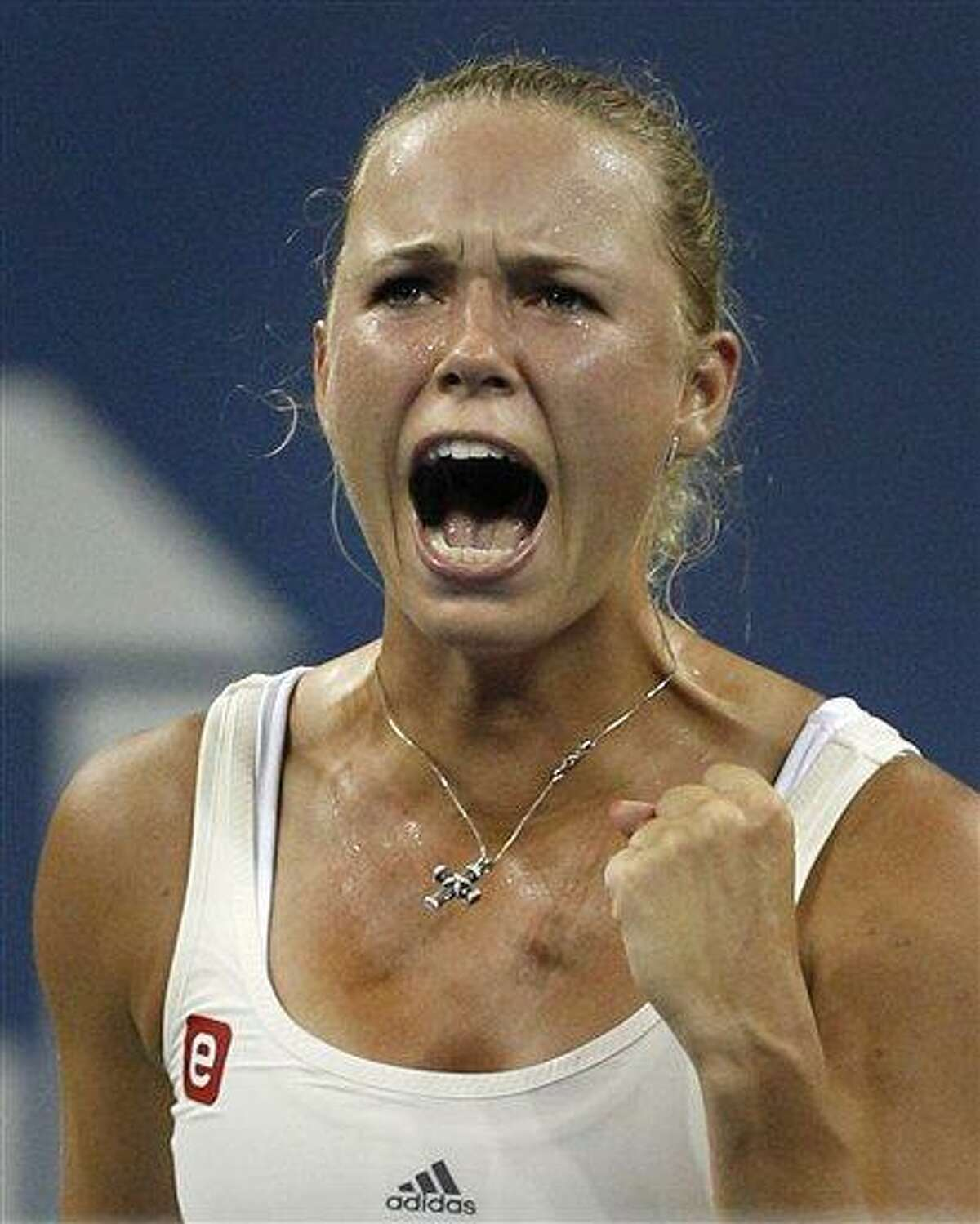 Caroline Wozniacki, of Denmark, reacts after winning a point in the second set of a match against Svetlana Kuznetsova, of Russia, during the U.S. Open tennis tournament in New York, Monday, Sept. 5, 2011. (AP Photo/Charles Krupa)