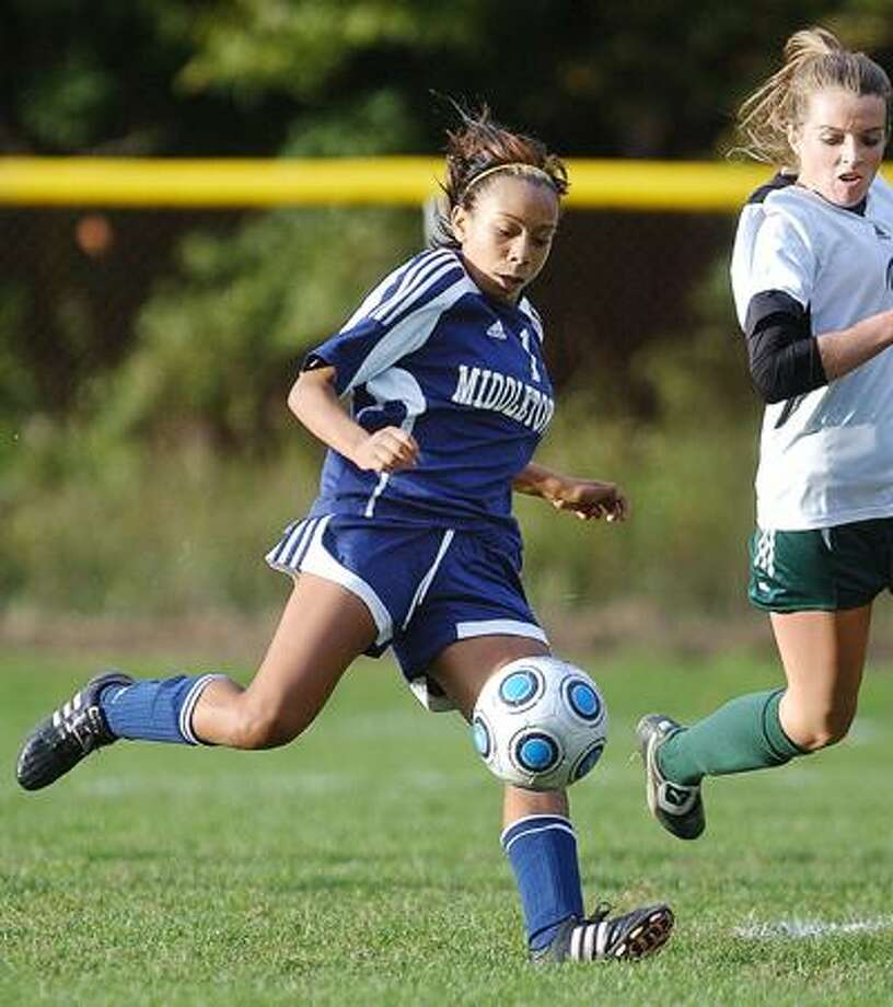 Middletown's Maariyah Lombardo readies a shot that results in a goal against Maloney last season. (Catherine Avalone