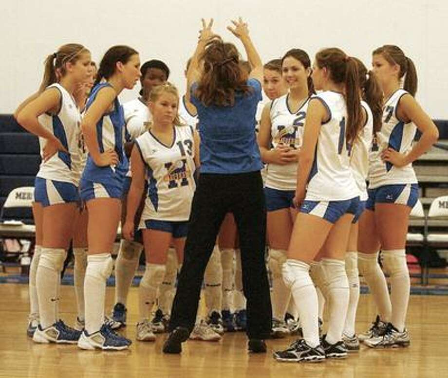 Mercy volleyball coach Duffy Lynch instructs her team during a huddle last season. (Catherine Avalone