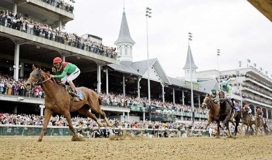 ASSOCIATED PRESS John Velazquez rides Animal Kingdom to victory during the 137th Kentucky Derby horse race at Churchill Downs Saturday in Louisville, Ky.